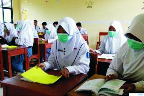 Proses PBM tatap muka di salah satu sekolah di tanah air pada masa pandemi Covid-19. NET
